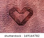Grunge heart embossed on rusty metal surface - Valentine concept - stock photo