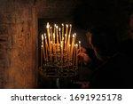 Lighting Candles Inside A Greek ...