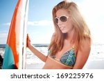 beautiful young woman surfer... | Shutterstock . vector #169225976