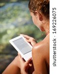 beautiful woman reading ebook... | Shutterstock . vector #169226075