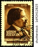 Small photo of Moscow, Russia - April 03, 2020: stamp printed in USSR (Russia) shows portrait of Sholem Aleichem (Solomon Naumovich Rabinovich, 1859-1916), leading Yiddish author and playwright, circa 1959