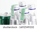 Small photo of BANGKOK THAILAND - MAR 2020: beverage excise stamp on beverage Bottle cap. background with other bottles and beverage can.