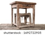 Small photo of Original old antique seventeenth century oak refectory shoemaker's table and chair isolated on white background