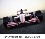 Race Car Racing On A Track...