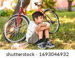 Shot Of A Young Boy Sitting On...