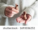 Woman\'s Hands Holding Two...