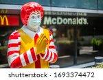 Small photo of Bangkok ,Thailand - April 01 2020 : Mr.Ronald McDonald or McDonald clown mascot wearing a Hygienic mask and waiting for customer because of Covid-19 or Coronavirus crisis, Illustrative Editorial