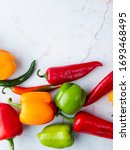 top view of peppers on white... | Shutterstock . vector #1693468495