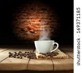 white cup of coffee  | Shutterstock . vector #169371185