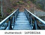 Wooden Bridge Over The River I...