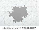 White Puzzle On A Colored...