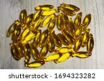 Fish Oil Capsules Spread Out On ...