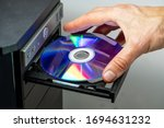 Hand Inserting Dvd Into A...