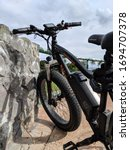 Small photo of Honolulu - March 8, 2019: Rad Power Bikes resting on top hill. A Seattle ebike company, Rad Power Bikes is a consumer direct ebike company making the RadRover electric fat bike.