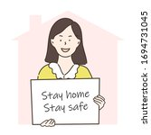 woman holding sign stay home  ... | Shutterstock .eps vector #1694731045