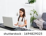 Scene Of Piano Lessons Online...