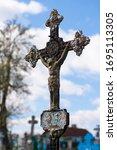 Rusty Iron Cross In An Old...