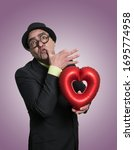 Small photo of Funny portrait of gigolo with heart balloon