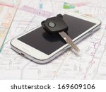 mobile phone and key car on the ... | Shutterstock . vector #169609106