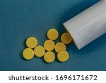Tablets And White Plastic Vial...