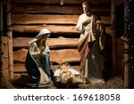 Small photo of LAGIEWNIKI, KRAKOW, POLAND- DECEMBER 28, 2013:The Centre of Pope John Paul II. nativity scene with figures made out of wood