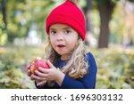 Cute Little Girl Eating An...