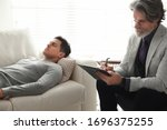 Psychotherapist And Patient In...