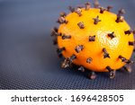 a tangerine with cloves as... | Shutterstock . vector #1696428505
