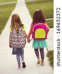 little girls walking to school...   Shutterstock . vector #169652372
