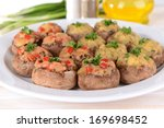 stuffed mushrooms on plate on... | Shutterstock . vector #169698452