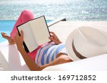 Woman Reading Book Relaxed In...
