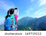 Hiking Woman Taking Photo With...