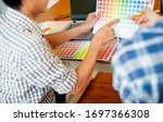 designers discuss color samples ...