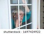 Woman Looks Longingly Outside...