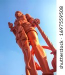 Small photo of Huge red(sindoor) color statue of hanuman. He is an ardent devotee of Rama. Hanuman is one of the central characters of the Indian epic Ramayana.
