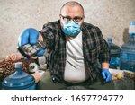 Man In Medical Mask Watching Tv ...