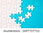 Many white jigsaw puzzle on...