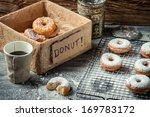 Tasting sweet donuts with powder sugar - stock photo