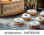 Fresh donuts with powder sugar on cooling rack - stock photo