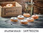 Closeup of falling powder sugar on donuts - stock photo
