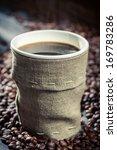Freshly hot coffee in burlap sack - stock photo