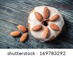 Closeup of donut with almond - stock photo