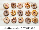 Group of colorfully decorated donuts - stock photo