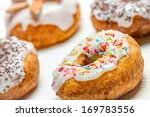 Freshly baked donuts with sprinkles - stock photo