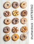 Large group of variously decorated donuts - stock photo