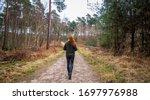 Red Hair Girl Walking Through ...