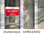 Business center closed due to COVID-19, sign with sorry in door. Stores, offices, other public places temporarily closed during coronavirus pandemic. Economy hit by corona virus. Lockdown concept.