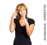 Small photo of Closeup portrait of an angry pretty young woman gesturing with her finger against temple asking are you crazy? Isolated on white background. Negative human emotions facial expression feelings
