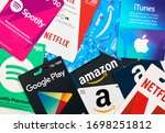 Small photo of Montreal, Canada - April 6, 2020: Different gift cards of many brands such as Amazon, Netflix, Xbox, Google Play, Best Buy, Spotify. A gift card is a prepaid card that you use to pay for purchases