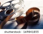 Movie Reel On A Wooden...